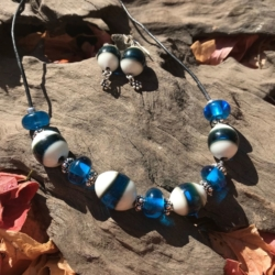Sea inspired necklace and earring set made from French vanilla and sea blue glass rods.