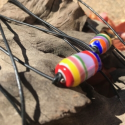 Rainbow inspired lampwork donut bead.