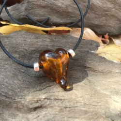Burnt orange love heart lampwork bead leather necklace on adjustable leather cord.