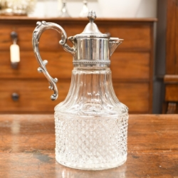 A VINTAGE SILVER PLATED GLASS CLARET JUG
