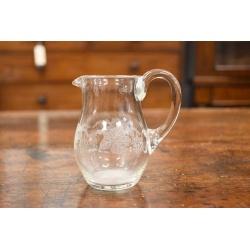 A SMALL HAND BLOWN GLASS MILK JUG