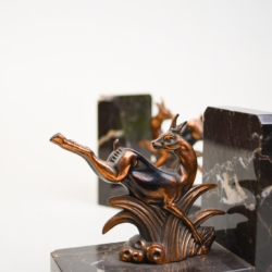 A PAIR OF BLACK MARBLE ART DECO BOOKENDS