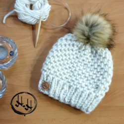 """Skagen"" Hand Knitted Beanie with Faux Fur Pom Pom in Cream"