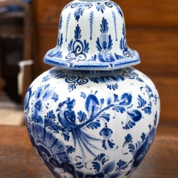 A LARGE DELFT BLUE AND WHITE LIDDED URN