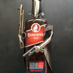 NUTS & BOLTS WINE HOLDERS – NED KELLY holds Bundy Rum 700ml & 1 ltr – $40
