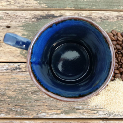 Vivid blue artisan handmade mug with handmade mulberry paper packaging