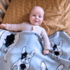 Baby Boy wrapped under a Branberry Australian made knitted merino wool French bulldog (frenchie) blanket in Pale Blue