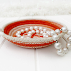 Orange coloured ombre hand dyed ring dish made from coiled rope