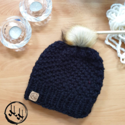 """Skagen"" Hand Knitted Beanie with Faux Fur Pom Pom in Black"