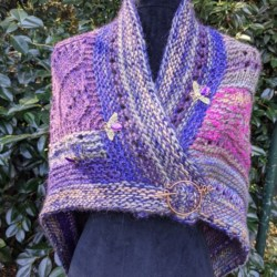 Warm triangular shawl in shades of purple with gorgeous jewelled bees .Comes with shawl pin
