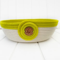 Coiled rope bowl made with hand dyed chartreuse coloured rope and finished with smart wooden button