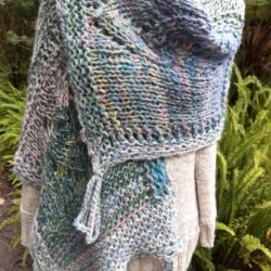 Knitted wool, silk and alpaca shawl in pastel shades