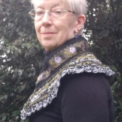 Handknitted cowl /collar in purple , green and black wool and silk featuring a jewelled green and gold bee