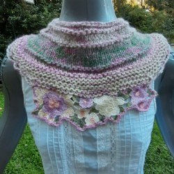 Soft wool and silk cowl in pastel tones and featuring a beautiful floral embroidery piece.