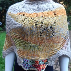 Handknitted wrap/cape in cremes and yellows – Size Small 10 -12