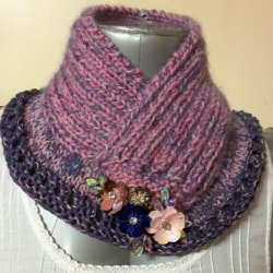 Handknitted cowl in pinks and blues with a fabulous jewelled floral touch