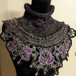 Handknitted black and purple cowl with beautiful floral edging