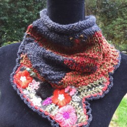Handknitted cowl in charcoal grey and autumn tones with lovely floral feature