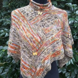Handknitted wrap/ cape/ short poncho in autumn shades of hand dyed yarn