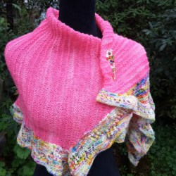 Handknitted hot pink and rainbow trimmed shawl