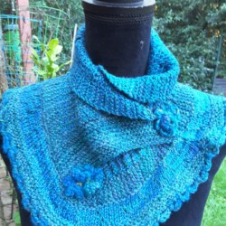 Handknitted turquoise and blue cowl