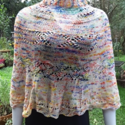 Hand knitted cape/short poncho in hand dyed yarn