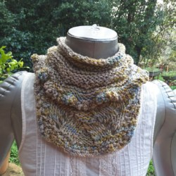 Handknitted cowl in creme cotton and variagated wools
