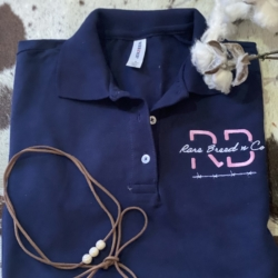 The Draft range -Ladies Polo Shirt – Navy (pink/white embroidery)