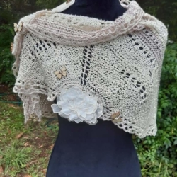 Handknitted shawl/ wrap in palest pink and creme silk and merino/silk yarn