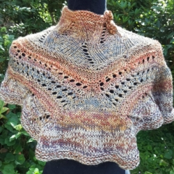 Hand knitted short cape/poncho in autumn shaded pure wool