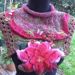 Handknitted cowl with flowers