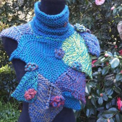 Handknitted scarf/ wrap/cowl with leaves and flowers